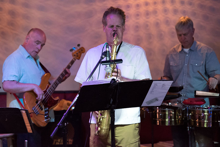 Las Gatos, with Paul VornHagen on tenor sax, performs Live Salsa at Rush Street in downtown Ann Arbor Thursday night.