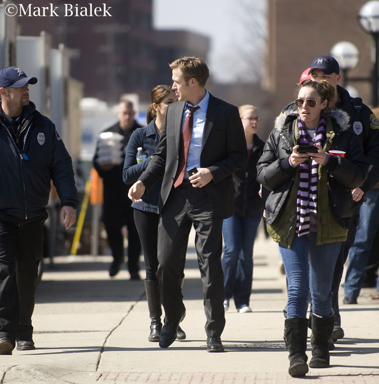 """Ryan Gosling walking to and from """"Ides"""" movie set and with his dog in Ann Arbor, Michigan"""